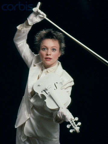 1983 --- Laurie Anderson Playing White Violin --- Image by © Deborah Feingold/Corbis